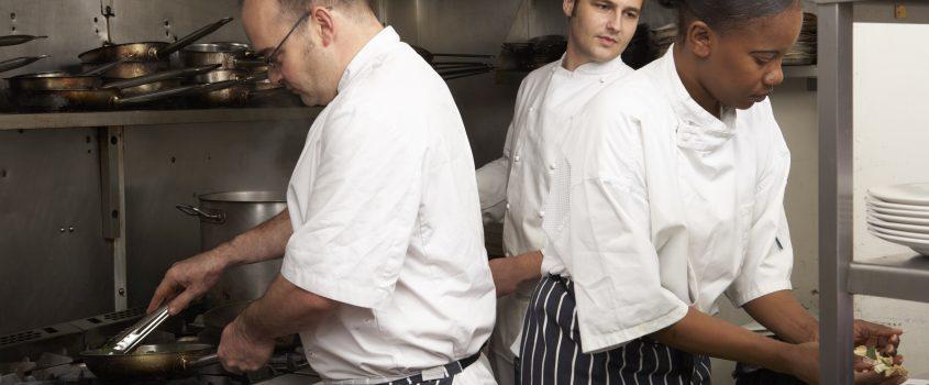 Tre kockar i ett kök